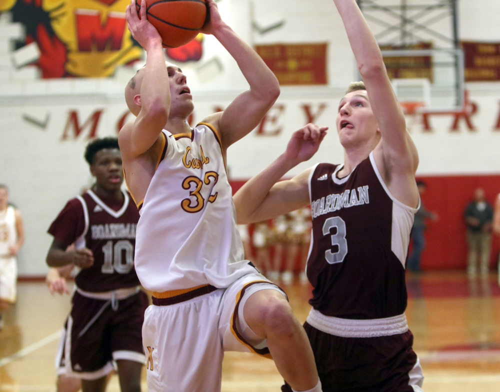 ROBERT  K. YOSAY | THE VINDICATOR..Boardmn at Cardinal Mooney .first quarter action as Mooney #32 Johnnie Mikos goes up for to.as defender Boardman #3 Ryan Archey- behind them #10 Derrick Anderson