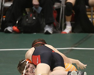 Canfield 126 pound wrestler McCoy Watkins Burcsak gets a hold on Claymont 126 pound wrestler Seth Ferguson in the quarter finals of the OHSAA State Wrestling Dual Team Tournament, Sunday, Feb. 11, 2018, at Ohio State University's St. John Arena in Columbus...(Nikos Frazier | The Vindicator)
