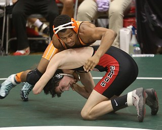 Claymont 132 pound wrestler Jerome Tucker moves around Canfield 132 pound wrestler Aidan Burcsak in the quarter finals of the OHSAA State Wrestling Dual Team Tournament, Sunday, Feb. 11, 2018, at Ohio State University's St. John Arena in Columbus...(Nikos Frazier | The Vindicator)