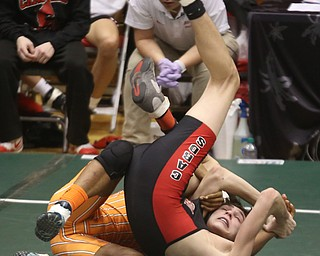 Claymont 132 pound wrestler Jerome Tucker flips over Canfield 132 pound wrestler Aidan Burcsak in the quarter finals of the OHSAA State Wrestling Dual Team Tournament, Sunday, Feb. 11, 2018, at Ohio State University's St. John Arena in Columbus...(Nikos Frazier | The Vindicator)