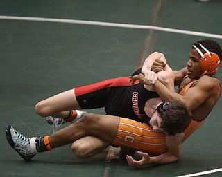 Claymont 132 pound wrestler Jerome Tucker pulls back on Canfield 132 pound wrestler Aidan Burcsak in the quarter finals of the OHSAA State Wrestling Dual Team Tournament, Sunday, Feb. 11, 2018, at Ohio State University's St. John Arena in Columbus...(Nikos Frazier | The Vindicator)