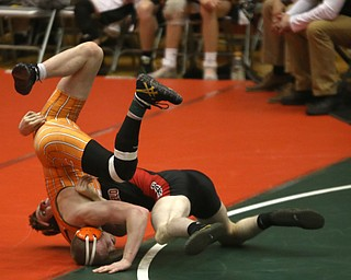 Canfield 152 pound wrestler David Reinhart flips Claymont 152 pound wrestler Briar Cadle out of bounds in the quarter finals of the OHSAA State Wrestling Dual Team Tournament, Sunday, Feb. 11, 2018, at Ohio State University's St. John Arena in Columbus...(Nikos Frazier | The Vindicator)