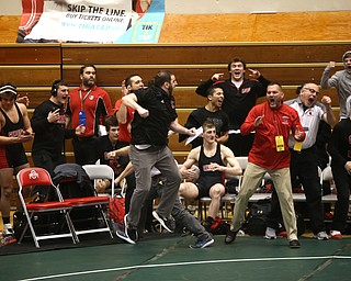 The Canfield bench reacts to Ben Cutrer's pin in the quarter finals of the OHSAA State Wrestling Dual Team Tournament, Sunday, Feb. 11, 2018, at Ohio State University's St. John Arena in Columbus...(Nikos Frazier | The Vindicator)