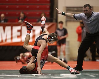 Canfield 106 pound wrestler Ethan Fletcher flips around to gain a better grip on Wauseon 106 pound wrestler Damon Molina in the semi finals of the OHSAA State Wrestling Dual Team Tournament, Sunday, Feb. 11, 2018, at Ohio State University's St. John Arena in Columbus...(Nikos Frazier | The Vindicator)
