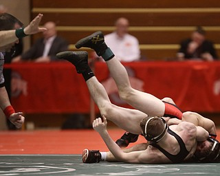 Wauseon 152 pound wrestler Gage Grunden attempts to pin Canfield 152 pound wrestler David Reinhart in the semi finals of the OHSAA State Wrestling Dual Team Tournament, Sunday, Feb. 11, 2018, at Ohio State University's St. John Arena in Columbus...(Nikos Frazier | The Vindicator)