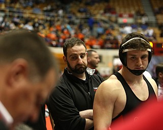 Canfield head coach Stephen Pitts(center) and Tyler Stein watch as the final matches are tallied resulting in a 33-38 loss to Wauseon in the semi finals of the OHSAA State Wrestling Dual Team Tournament, Sunday, Feb. 11, 2018, at Ohio State University's St. John Arena in Columbus...(Nikos Frazier | The Vindicator)