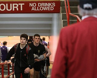 The Canfield wrestling team, including Tyler Stein(center) exits the arena floor after loosing to Wauseon, 33-28, in the semi finals of the OHSAA State Wrestling Dual Team Tournament, Sunday, Feb. 11, 2018, at Ohio State University's St. John Arena in Columbus...(Nikos Frazier | The Vindicator)