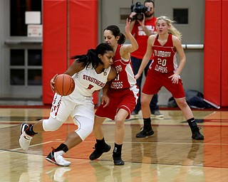 Struthers' Khaylah Brown (1) dribbles into Columbiana's Grace Hammond (10) in the second quarter of an OHSAA high school basketball game, Monday, Feb. 12, 2018, in Struthers. Struthers won 61-52...(Nikos Frazier | The Vindicator)