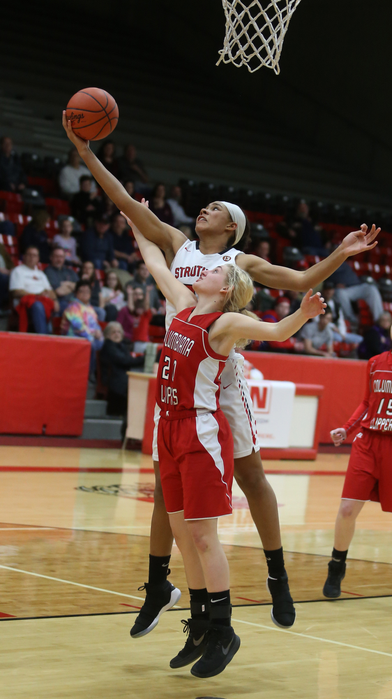 Struthers' Trinity McDowell (23) reaches past Columbiana's Alexis Cross (20) for the rebound in the third quarter of an OHSAA high school basketball game, Monday, Feb. 12, 2018, in Struthers. Struthers won 61-52...(Nikos Frazier   The Vindicator)