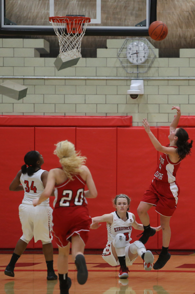 Columbiana's Kayla Muslovki (4) goes up for a layup on top of Struthers' Alexis Bury (13) in the fourth quarter of an OHSAA high school basketball game, Monday, Feb. 12, 2018, in Struthers. Struthers won 61-52...(Nikos Frazier   The Vindicator)