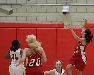 Columbiana's Kayla Muslovki (4) goes up for a layup on top of Struthers' Alexis Bury (13) in the fourth quarter of an OHSAA high school basketball game, Monday, Feb. 12, 2018, in Struthers. Struthers won 61-52...(Nikos Frazier | The Vindicator)
