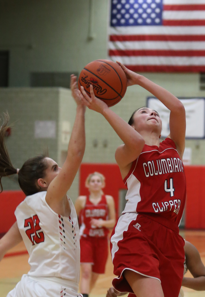 Columbiana's Kayla Muslovki (4)'s layup is blocked by Struthers' Michelle Buser (22) in the fourth quarter of an OHSAA high school basketball game, Monday, Feb. 12, 2018, in Struthers. Struthers won 61-52...(Nikos Frazier   The Vindicator)
