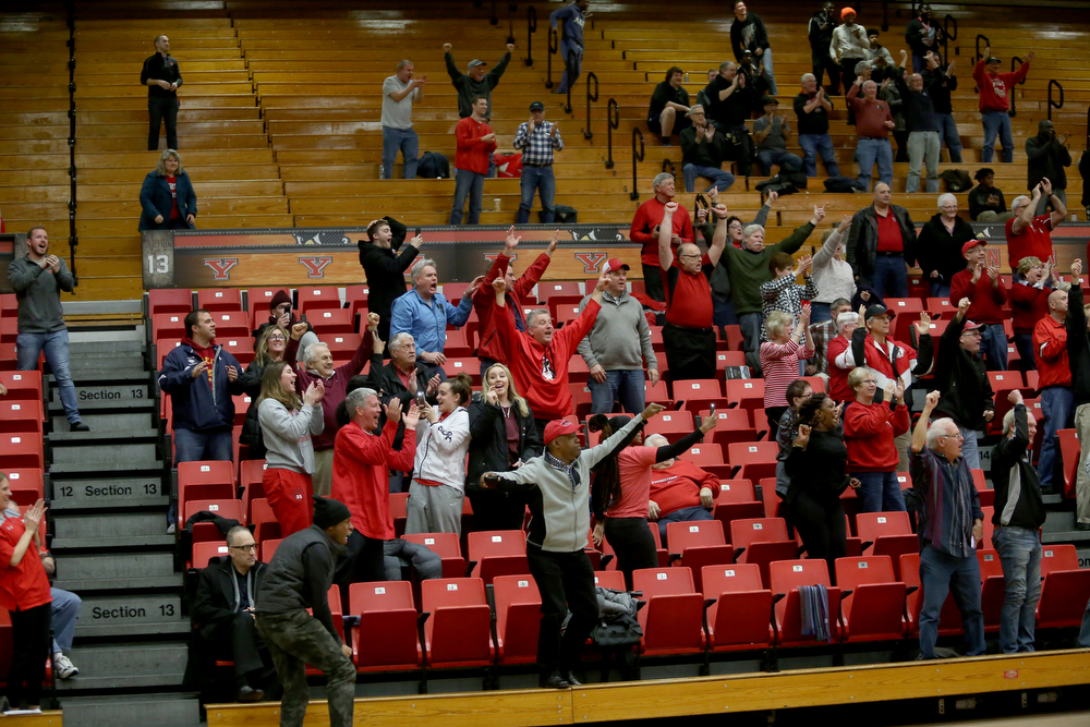 Spectators react to Youngstown State guard Garrett Covington (32)'s buzzer beater basket in the second half of an NCAA Horizon League college basketball game, Wednesday, Feb. 14, 2018, in Youngstown. YSU won 75-73...(Nikos Frazier | The Vindicator)
