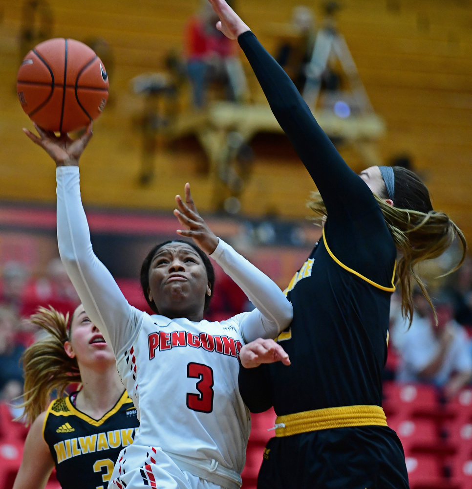 YOUNGSTOWN, OHIO - FEBRUARY 15, 2018: Youngstown State's Indiya Benjamin goes to the basket against Milwaukee's Steph Kostowicz during the first half of their game on Thursday night at Beeghly Center. DAVID DERMER | THE VINDICATOR