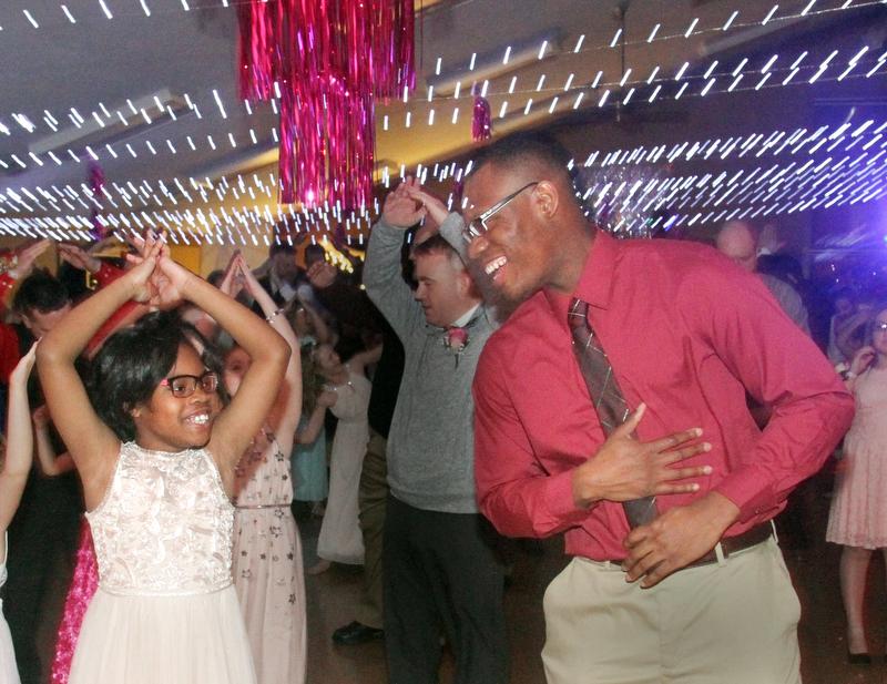 William D. Lewis The Vindicator  Darryl Alexander of Boardman and his daughter  Callie Alexander,9, ,dance during 2-17-18 Daddy Daughter Dance at Boardman Park.
