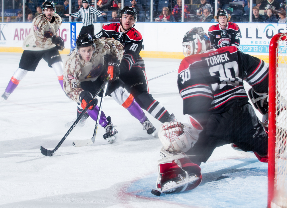 Scott R. Galvin | The Vindicator.Youngstown Phantoms right wing Max Ellis (6) watches as Waterloo Black Hawks goalie Matej Tomek (30) makes a save on his shot during the second period at the Covelli Centre on Saturday, February 17, 2018.