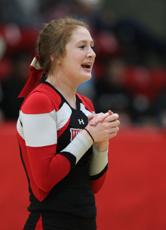 Struthers freshman cheerleader ,Emily Basista, performs a cheer between quarters during Tuesday nights matchup against McDonald at Struthers High School.  Dustin Livesay  |  The Vindicator  2/20/18 Stuthers