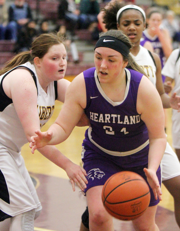 William D Lewis The Vindicator  Liberty's Melanie Bardel(33) defends as )  Heartland's Jana Croyts(24) dribbles during 2-21-18 action at Liberty.