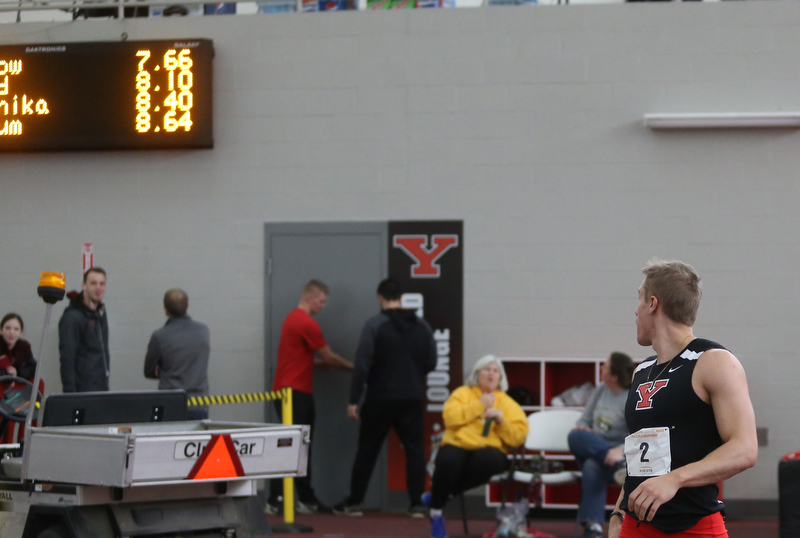 Youngstown's Chad Zallow looks up at the video board after running the prelim Men's 60 meter hurdles during the first day of the 2018 Horizon League Indoor Championships, Saturday, Feb. 24, 2018, in Youngstown...(Nikos Frazier | The Vindicator)