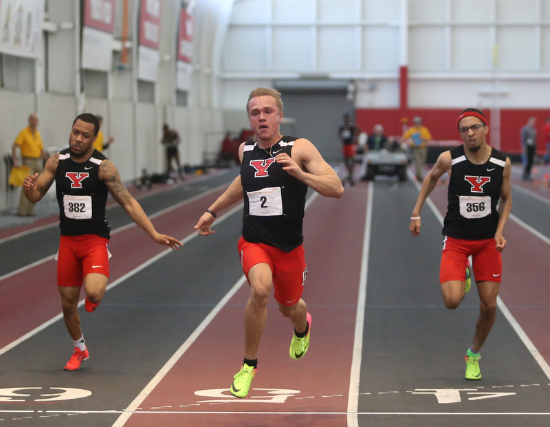 Youngstown's Chad Zallow(center), Josh Beaumant(right) and Lasander Washington run the prelim Men's 60 meter dash during the first day of the 2018 Horizon League Indoor Championships, Saturday, Feb. 24, 2018, in Youngstown...(Nikos Frazier   The Vindicator)