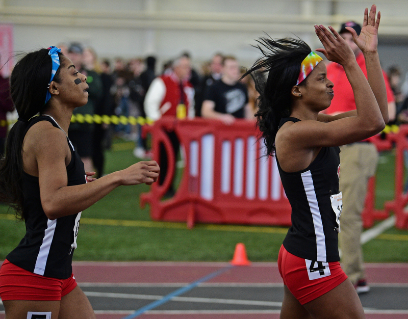 YOUNGSTOWN, OHIO - FEBRUARY 25, 2018: Youngstown State's Jaliyah Elliot, right, claps her hands in celebration after wining the women's 60 meter dash during the Horizon League Indoor track Championship meet. DAVID DERMER | THE VINDICATOR..Youngstown State's Keishawnna Burts pictured.