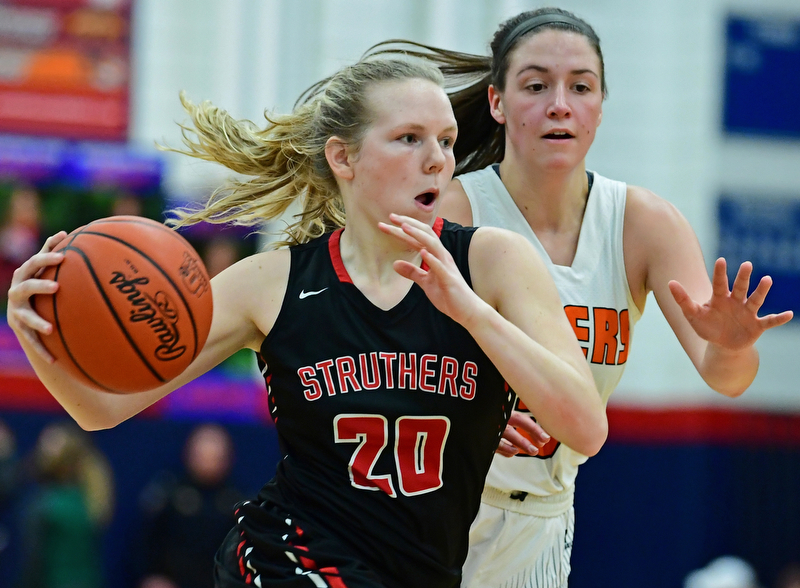 AUSTINTOWN, OHIO - FEBRUARY 26, 2018: Struthers' Renee Leonard drives on Howland's Kamryn Buckley during the first half of their OHSAA district tournament game at Fitch High School. Howland won 35-24. DAVID DERMER | THE VINDICATOR