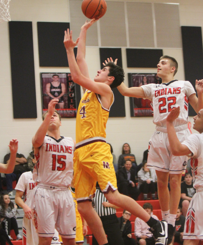William D. Lewis The Vindicator Mooney's Mark Phillips(4) shoots past Girard's Mark Waid(15) and Christian Graziano(22).).