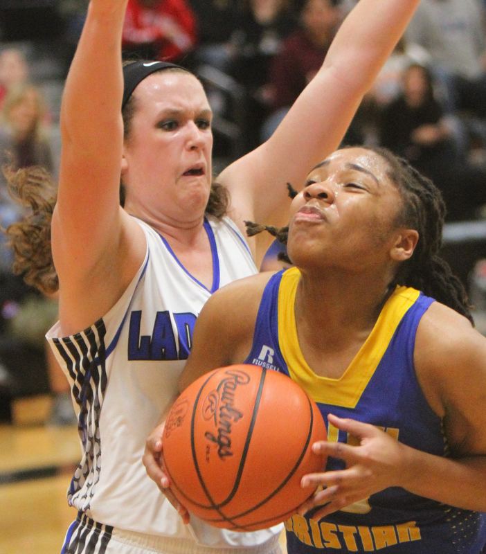 William D. Lewis The Vindicator   Valley Christian ITaylor Jones(00)) keeps the ball from Jackson's Ashley Cameron(20)) during 2-28-18 action at Ridge.