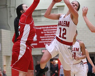 Salem's Ellie Davidson (12) goes up for a shot while being defended by Columbiana's Kennedy Fullum (15) during  the second half of Wednesday nights matchup at Struthers High School.  Dustin Livesay  |  The Vindicator  2/28/18  Struthers