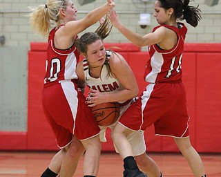 Allie Davidson-Chuck (22) of Salem gets double teamed by Alexis Cross (20) and Grace Hammand (10) of Columbiana during the second hald of Wednesday nights matchup at Struthers High School.  Dustin Livesay  |  The Vindicator  2/28/18  Struthers