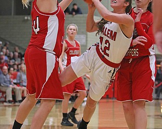 Salem's Ellie Davidson (12) tries to put up a shot while being defended by Columbiana's Marisa McDonough (14) and Kennedy Fullum (15) during  the second half of Wednesday nights matchup at Struthers High School.  Dustin Livesay  |  The Vindicator  2/28/18  Struthers