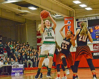 Scott Williams - The Vindicator - West Branch's Sarrah Tennefoss (#24) goes up for a shot while Howland's Jenna DeSalvo (#12) and Alex Ochman (#20) try to block at their playoff game at Austintown Fitch on Thursday March 1, 2018.