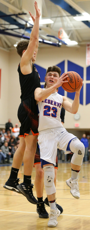 BERLIN CENTER, OHIO - MARCH 2, 2018: Western Reserve's Cole DeZee (23) drives to the hoop against Springfield's Evan Ohlin (1) during the 2nd qtr at Western Reserve High School.  MICHAEL G. TAYLOR | THE VINDICATOR