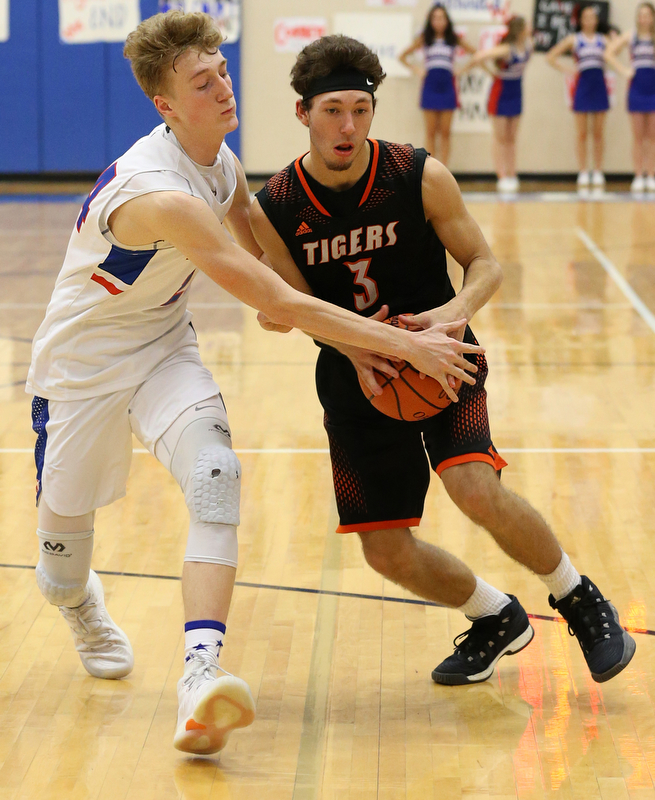 BERLIN CENTER, OHIO - MARCH 2, 2018:  Western Reserve's Kade Hilles (24) defends by Springfield's Brandon Walters (3) the 3rd qtr at Western Reserve High School.  MICHAEL G. TAYLOR | THE VINDICATOR