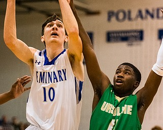 Poland's Dan Kramer gets past Ursuline defender RJ Clark on the way to the basket during sectional tournament action in Poland on Friday night. Poland won 68-47...Photo by Dianna Oatridge