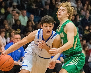 Poland's Braeden O'Shaughnessy drives past Ursuline's Vince Armeni during Poland's 68-47 sectional tournament win at Poland on Friday night...Photo by Dianna Oatridge.