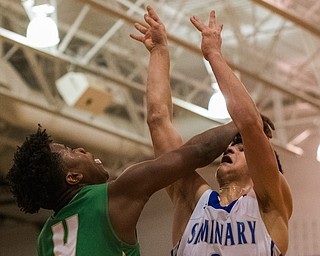 Ursuline's Travis Easterly and Poland's Braeden O'Shaughnessy battle for a rebound during the third quarter of sectional tournament action in Poland on Friday night. Poland won 68-47...Photo by Dianna Oatridge
