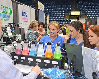 Three Mercy College of Ohio students, from left to right, Autumn Miller, Lauren McIntosh, and Maria Patsko try out an Euphorium Oxygen Bar as Jeff Mahood from Boardman Medical Supply explains the benefits.  An Euphorium Oxygen Bar is recreational oxygen and can be rented for private events and parties. ..Photo by Scott Williams, The Vindicator..