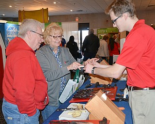 Dennis and Bev Tucholski try out some knives from The Cutco Kitchen as Nate Bratton explains their products at the HBA Home and Garden Show held at Mr. Anthony's in Boardman on Saturday, March 3, 2018...Photo by Scott Williams, The Vindicator.