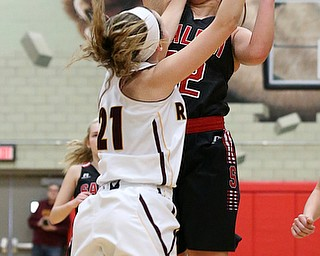 STRUTHERS, OHIO - MARCH 3, 2018:  Salem's Allee Davidson-Chuck (22) is fouled as she shoots against South Range's Samantha Patrone (21) during the 2nd qtr at Struthers High School, Struthers' Fieldhouse.  MICHAEL G. TAYLOR | THE VINDICATOR