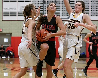 STRUTHERS, OHIO - MARCH 3, 2018:  Salem's Ellie Davidson (12) drives to the hopp between South Range's Maddie Durkin (13)(left) and Dani Vuletich (25) during the 3rd qtr at Struthers High School, Struthers' Fieldhouse.  MICHAEL G. TAYLOR | THE VINDICATOR