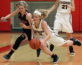 STRUTHERS, OHIO - MARCH 3, 2018:  South Range's Bree Kohler (12) has the ball stolen by Salem's Casey Johnson (4) during the 4th qtr at Struthers High School, Struthers' Fieldhouse.  MICHAEL G. TAYLOR | THE VINDICATOR
