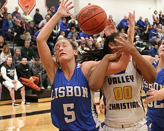 Lisbon's Chloe Smith (5) fights for a rebound with Valley Christian's Taylor Jones (00) during the second half of Saturday afternoons championship matchup at Mineral Ridge.  Dustin Livesay  |  The Vindicator  3/3/18  Mineral Ridge.