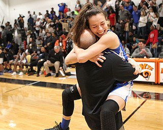 Izzy Perez of Lisbon hugs head coach Jamie Entrikin after defeating Valley Christian in the division championship game at Mineral Ridge on Saturday afternoon.  Dustin Livesay  |  The Vindicator  3/3/18  Mineral Ridge.