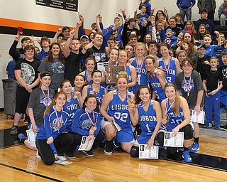 The Lisbon Blue Devils pose with the student section after they defeated Valley Christian on Saturday afternoon to become division champions at Mineral Ridge.   Dustin Livesay  |  The Vindicator  3/3/18  Mineral Ridge.