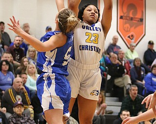 Valley ChristiansNe'Syiah Taylor (23) goes up for a shot while being defended by Lisbon's Chloe Smith (5) during the first half of Saturday afternoons championship matchup at Mineral Ridge.  Dustin Livesay  |  The Vindicator  3/3/18  Mineral Ridge.