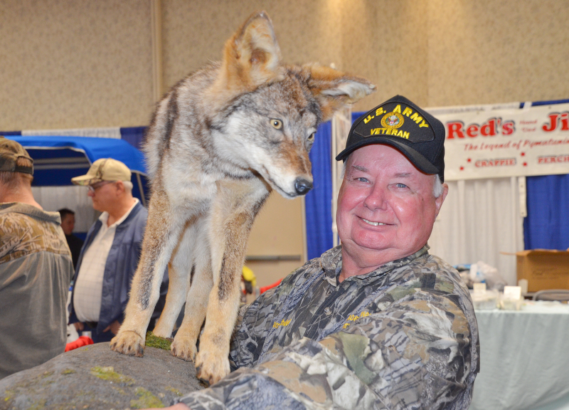 Tom Bechdel, from Meadville, PA, carries his stuffed and mounted coyote back to the car as The Sportsman's Hunting and Fishing Supershow and Sale draws to a close at the Metroplex Expo Center in Girard, Ohio on Sunday March 4, 2018.  Bechdel had a booth set up and was selling a coyote hunting DVD that he made...Photo by Scott Williams - The Vindicator.