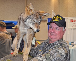 Tom Bechdel, from Meadville, PA, carries his stuffed and mounted coyote back to the car as The Sportsman's Hunting and Fishing Supershow and Sale draws to a close at the Metroplex Expo Center in Girard, Ohio on Sunday March 4, 2018.  Bechdel had a booth set up and was selling a coyote hunting DVD that he made. He shot this coyote in Albright, WV...Photo by Scott Williams - The Vindicator..