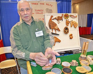 Jim Pasquale, from Howland, Ohio, demonstrates one of his hand made turkey calls at The Sportsman's Hunting and Fishing Supershow and Sale at the Metroplex Expo Center in Girard, Ohio on Sunday March 4, 2018.  Pasquale has hand carved turkey calls and wall decorations for nearly twenty-five years since his retirement. ..Photo by Scott Williams - The Vindicator.