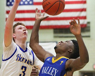 William D. Lewis The Vindicator  Valley's Jamynk Jackson(4) goes for a rebound with East Canton's Trey Mallonn(3) during 3-6-18 action in Struthers.